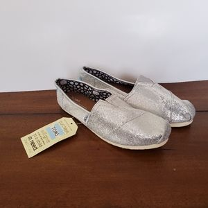 NWT silver sparkle Toms slip on flat shoe